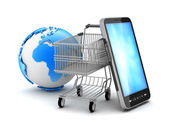 Shopping cart, cell phone and earth globe — Stock Photo