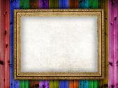Picture frame on wooden background — Foto Stock