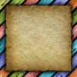 Old handmade paper or canvas sheet on colored background  — Stock Photo