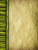 Creased handmade paper sheet and bamboo sticks — Stock Photo
