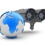 Security camera and earth globe — Stock Photo
