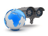 Security camera and earth globe — Stock Photo