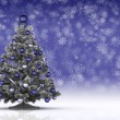 Christmas tree on snowflake background — Stock Photo