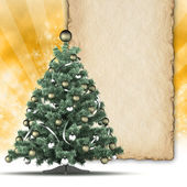 Christmas tree and blank paper sheet for text — Photo