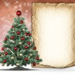 Christmas tree and handmade paper sheet — Stockfoto