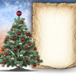 Stock Photo: Christmas tree and paper sheet for text