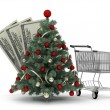 Christmas tree, shopping cart and dollar bills — Stock Photo