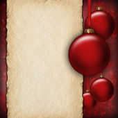 Christmas background - red baubles and blank paper sheet — Stock Photo