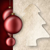 Christmas background - baubles, shape of xmas tree and blank pap — Stock Photo