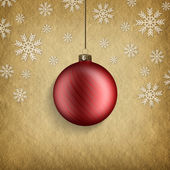 Red Christmas bauble and snowflakes — Zdjęcie stockowe