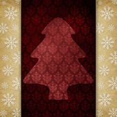 Christmas background - shape of tree and snowflakes — Stock Photo