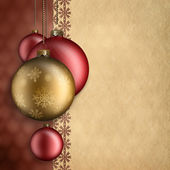 Christmas background - red and gold baubles — Stock Photo
