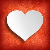 Valentine's Day - White heart on red patterned background — Stock Photo