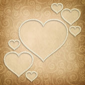 Valentine's Day - hearts on patterned background — Stock Photo