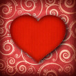 Stock Photo: Red heart on patterned background