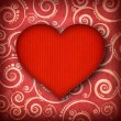 Red heart on patterned background — Stock Photo