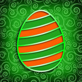 Easter egg on patterned background — Stock Photo
