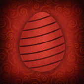 Red Easter egg on red background — Stock Photo