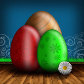Colored Easter eggs on wooden floor and blue patterned backgroun — Stok fotoğraf