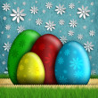 Colored Easter eggs and white flowers on background — Stock Photo