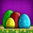 Colored Easter eggs and flowers — Stock Photo