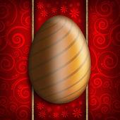 Happy Easter - Golden egg on red patterned background — Foto Stock