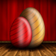 Happy Easter - Two Easter egg on wooden floor and red background — Stock Photo