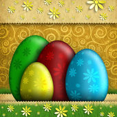 Easter eggs and flowers on patterned background — Stock Photo