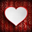 White heart in red frame on red patterned background — Stock Photo