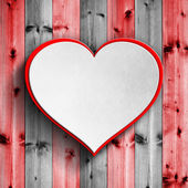 White and red heart on wooden background — Stock Photo