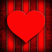 Red heart on red patterned background — Stockfoto