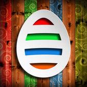 Shape of Easter egg on colored wooden background — Foto de Stock