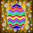 Happy Easter - colored egg on patterned background — Stock Photo