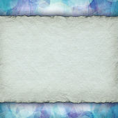 Handmade paper sheet on patterned background — Stock Photo
