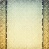 Blank handmade paper sheet on retro patterned background — Stock Photo