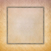Blank sheet in picture frame on crumpled paper background — Stock Photo