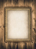 Picture frame on wooden background — Stock Photo
