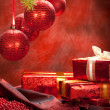 Christmas gifts and red baubles — Stock Photo #6522940