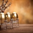 Easter - Golden eggs on brown background — Stock Photo #6672382