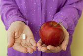 Healthy choice - pills or apple — Stock Photo