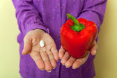 Healthy choice- medicine or red pepper — Stock Photo