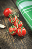 Cherry Tomatoes over wooden desk — Stock Photo