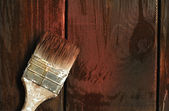 Old paint brush on a wooden background — Stock Photo