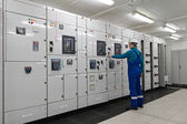 Man is in electrical energy distribution substation — Stock Photo