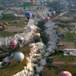 Hot air balloons rise over valley in Cappadocia, Turkey — Stock Photo