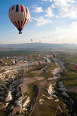 Hot air balloons rise over valley, Turkey — Stock Photo