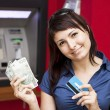 woman withdrawing money from credit card at atm — Stock Photo #12453645