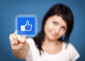 Woman clicking like button. She Likes it! — Stock Photo