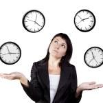 Businesswoman juggling clocks. Time Juggling Act. — Stock Photo