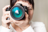 Woman photographer with camera — Stock Photo